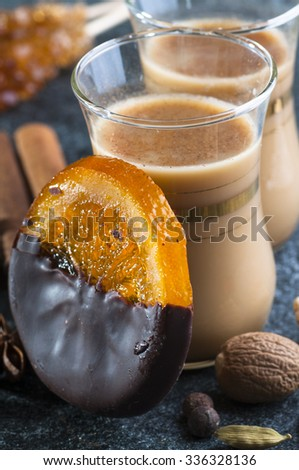 Indian masala tea with spices and orange marmalade in chocolate, close up - stock photo