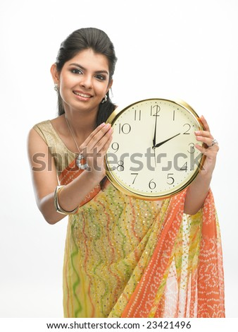 Indian model with a beautiful clock showing 2 o clock time - stock photo