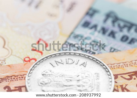 Indian money banknote focus on coin india - stock photo