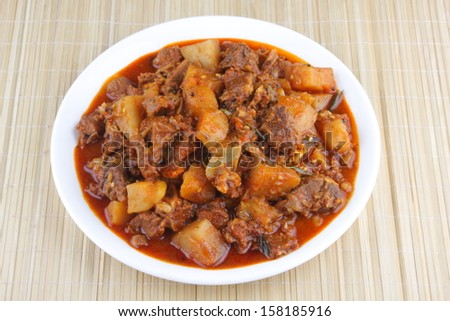 Indian Mutton curry with potatos- It goes well well with ghee rice, appam, parotta, puttu and chappathi.
