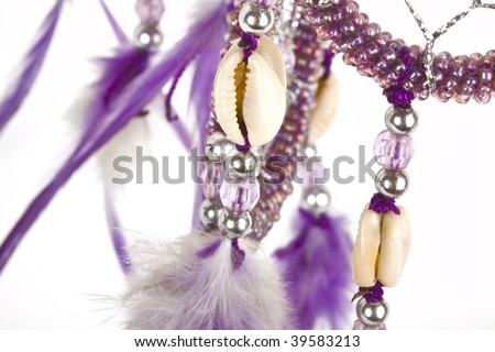 Indian native american purple dream  catcher with shiny beads detail.