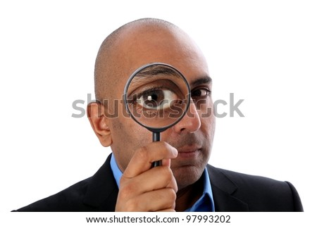 Indian o african Man with magnifying glass
