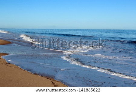 Indian Ocean waves rolling in at Mangles beach Bunbury Western Australia on a calm early morning in winter. - stock photo