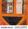 Indian pattern on fabric - stock photo