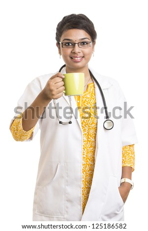 Indian petty female doctor with tea cup on white. - stock photo