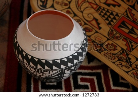 indian pot, blanket and bowl - stock photo