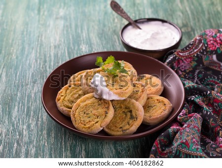Indian potato rolls with yogurtt sauce