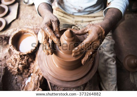 Indian potter at work - stock photo
