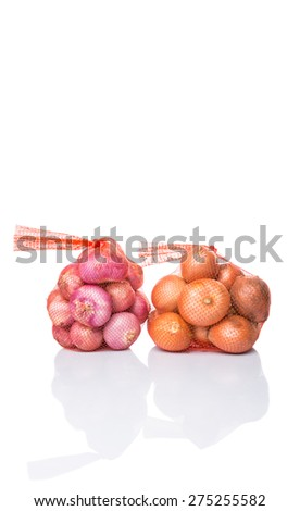 Indian red onion and Dutch yellow onion in plastic sack over white background - stock photo