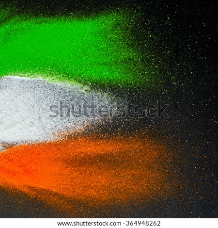 Indian Republic Day celebration background. Red, green and saffron color powders splashed over dark background.  - stock photo