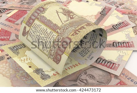 Indian Rs.500 over group of scattered Indian currency Rs.1000 Banknote. High resolution, sharp 3D rendering.