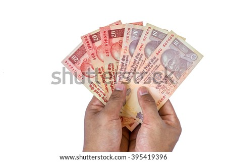 Indian rupee currency,money in a hand of business man isolated on white background - stock photo