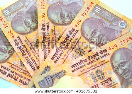 Indian rupee currency notes. Ten rupee notes on a white background.