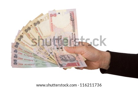 Indian rupee notes in hand  in white background - stock photo
