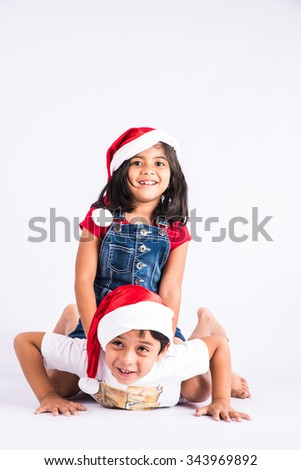 indian small kids showing happiness of christmas, christmas and happy kids, isolated on white background, indian kids and christmas, asian kids and christmas, - stock photo