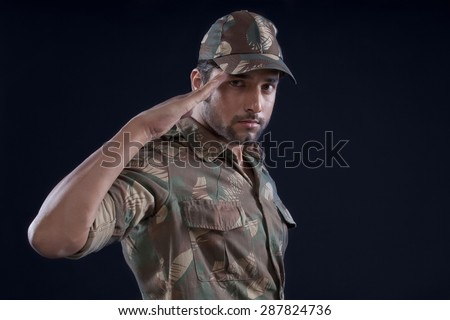 Indian soldier saluting - stock photo