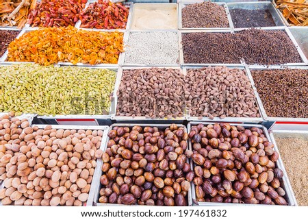 Indian spices herbs and nuts at street market - stock photo