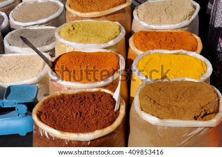 Indian spices in bags on the market  - stock photo