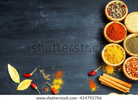 Indian spices with ground pepper,ginger, chili flakes, pepper seeds, bay leaves and cinnamon - stock photo