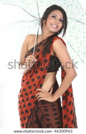 Indian teenage girl holding umbrella - stock photo