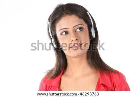 Indian teenage girl listening music - stock photo