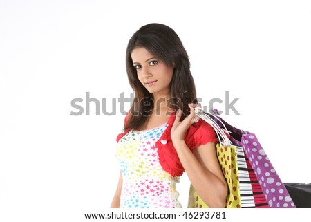 Indian teenage girl returning with shopping bags - stock photo