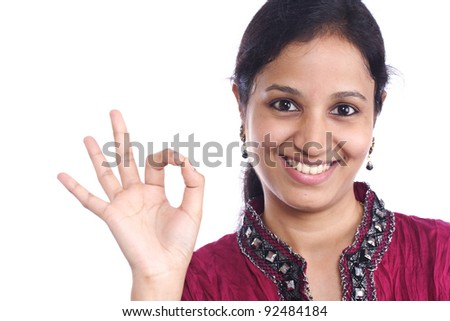indian teenager making OK sign - stock photo