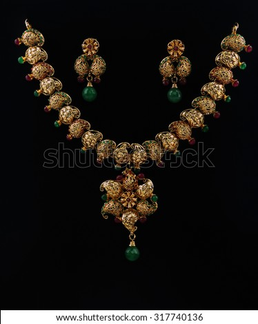 Indian Traditional Gold Necklace With Earrings - stock photo