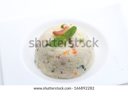 Indian Vegetarian Food - breakfast made from shredded wheat. - stock photo
