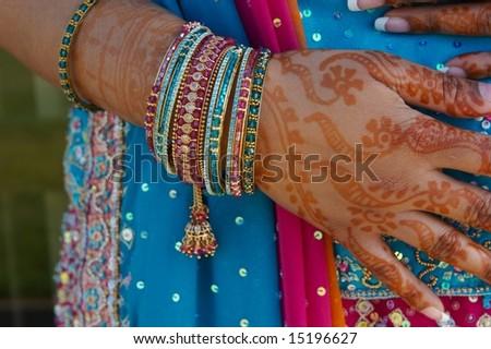 Indian wedding bride getting henna applied - stock photo