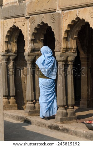 Indian woman at Chand Baori Stepwell in Jaipur, Rajasthan, India.  - stock photo