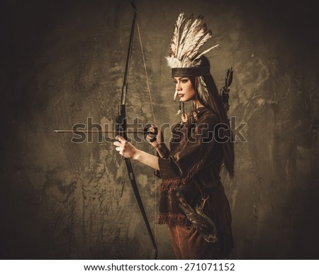 Indian woman hunter with bow and prey bird - stock photo