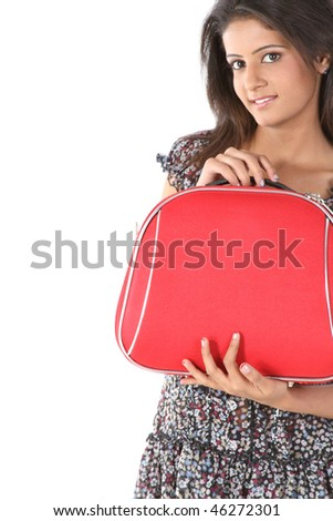 Indian woman in red suitcase with travelling mood - stock photo