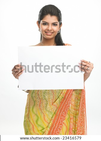 Indian woman in sari holding the white placard - stock photo