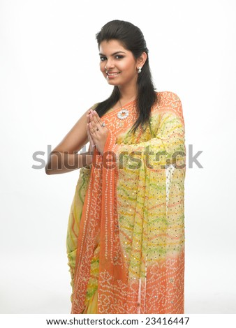 Indian woman in sari with a smiling welcome expression - stock photo