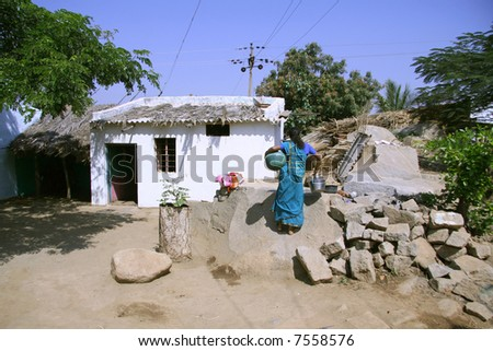 indian woman in village in hampi, india - stock photo