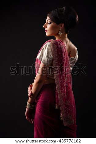 Indian woman on black background - stock photo