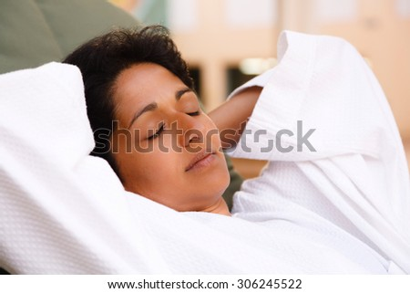 Indian woman relaxing - stock photo