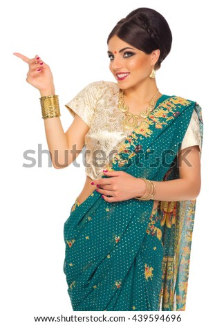 Indian woman shows pointing gesture isolated - stock photo