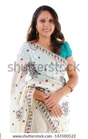 Indian woman smiling. Portrait of mid age beautiful Indian female in traditional saree standing isolated on white background. Indian model. - stock photo