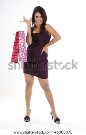 Indian woman standing with shopping bags - stock photo