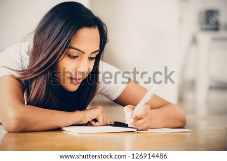 Indian woman student education writing studying - stock photo
