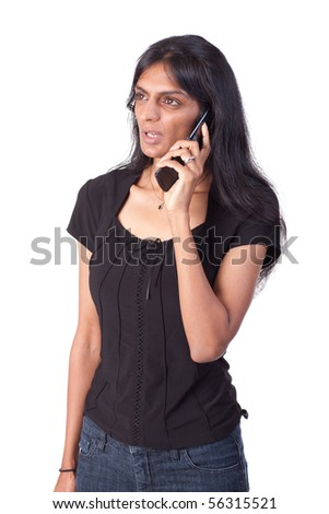Indian woman talking on a cell phone. - stock photo