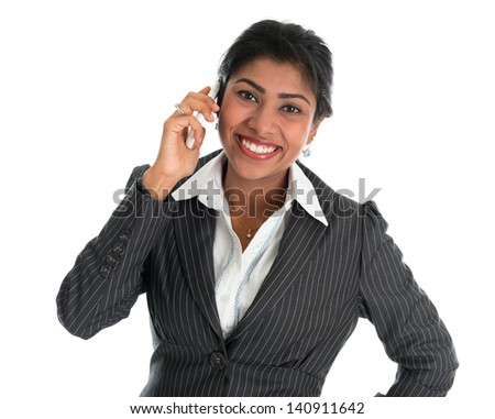 Indian woman talking on phone. Smart Indian business woman on the phone smiling happy isolated on white background. Beautiful Asian female model. - stock photo