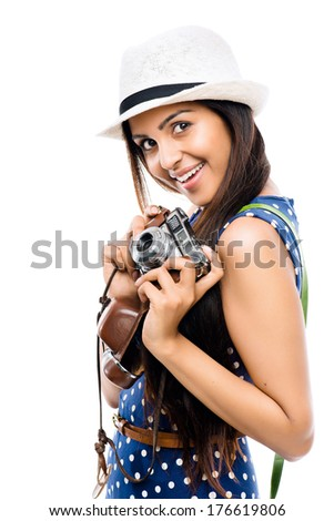 Indian woman tourist photographer hipster retro camera - stock photo