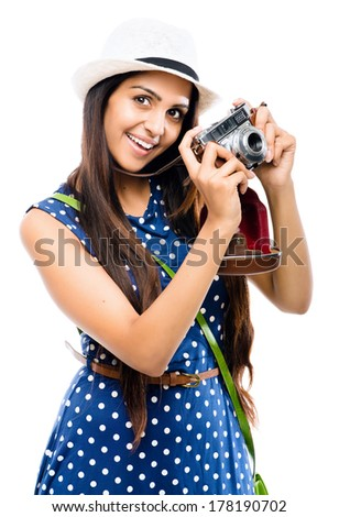 Indian woman tourist photographer hipster retro camera - stock photo
