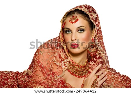 Indian woman wearing traditional red outfit.