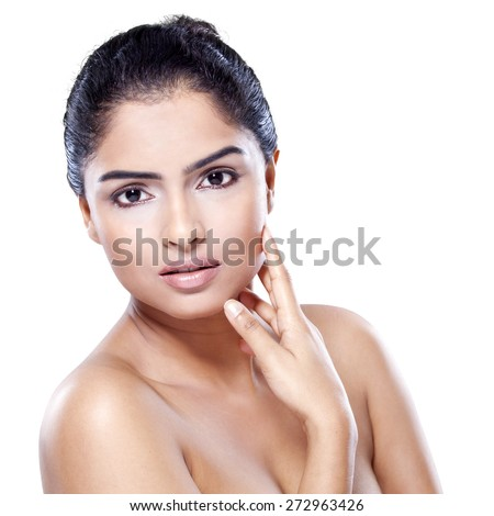 Indian woman with beautiful face and healthy skin, looking at the camera in the studio, isolated on white background - stock photo