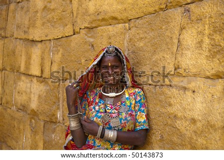 indian woman with traditional Rajasthani clothes and jewelry. Photo taken in Jaisalmer,India,Rajasthan - stock photo