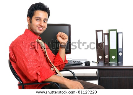 Indian young businessman in office